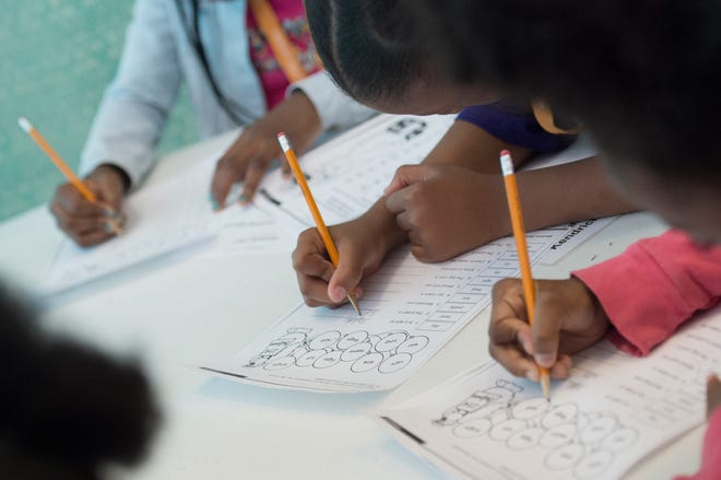 Students work hard on a phonics exercise in Mississippi. A bill that would have abolished a credentials test for those seeking to teach reading in California died despite the author's strong push to get it enacted.