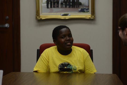 Sonovian Brown, 13, listens as a Jackson City Hall employee explains how to get a business license at Jackson City Hall on June 25, 2019. Brown started selling lemonade on the corner of Airways Boulevard and McCorry Street two years ago.