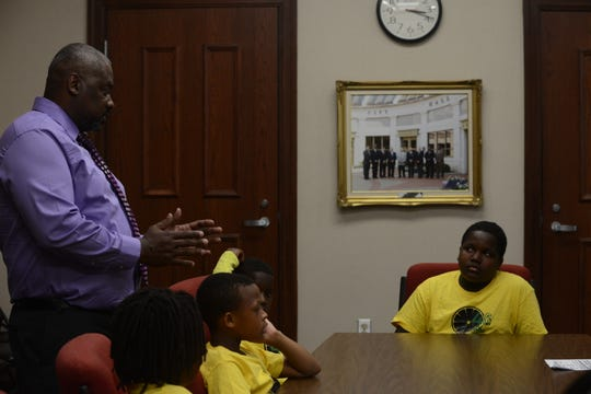 Gerkell Brooks, 11, Gerleek Triplett, 8, and Quantravious Woods, 10, and Sonovian Brown, 13, listen to Councilman Johnny Lee Dodd talk about starting a business in Jackson City Hall in Jackson, Tenn. on June 25, 2019.