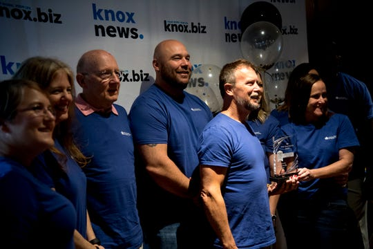 The Helen Ross McNabb Center takes a group photo at the 2019 Knox.Biz Top Workplaces event at The Foundry in Knoxville, Tennessee on Tuesday, June 25, 2019.