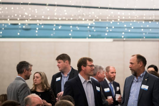 Attendees mingle at the 2019 Knox.Biz Top Workplaces event at The Foundry in Knoxville, Tuesday June 25, 2019.