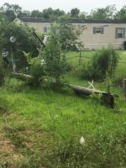 A dump truck latched onto a powerline in Duson Tuesday, snapping four poles and cutting off electricity for the entire town.