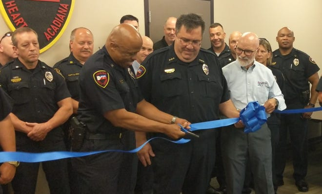 Lafayette Deputy Police Chief Reginald Thomas, left, cuts the ribbon with Police Chief Toby Aguillard, center, and Lafayette city-parish councilman Bruce Conque, right, Tuesday to officially open the Lafayette Police Department's new  firearm training facility.