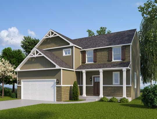 An architectural rendering of a two-story home shows one of a few types of homes to be built in a new subdivision soon to be under construction in Marion Township.