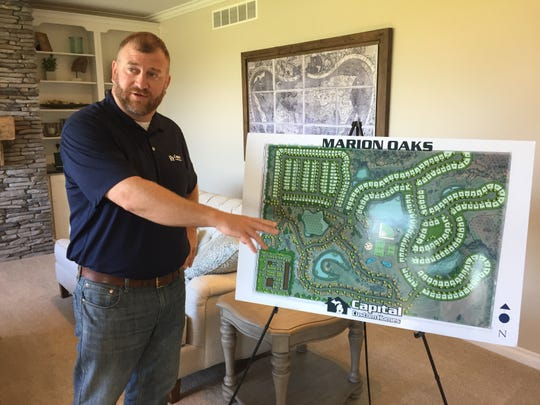 Capital Custom Homes owner Jack Lansing talks about plans for a 460-unit subdivision he is gearing up to start building in Marion Township, Tuesday, June 25, 2019.