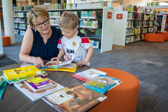 "Marilyn Dietz, left, reads to her grandson, Austin Dietz during a visit to the new Northeast Regional Louisville Free Public Library. ""Our Middletown branch closed and this is just amazing,"" Marilyn said. June 25, 2019"