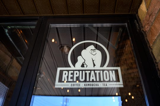 A new Reputation Beverage Co. sign is on the front door at TCB Coffee Co., which will soon be rebranded as Reputation Beverage Co., on Tuesday, June 25, 2019, at the DeWitt location.