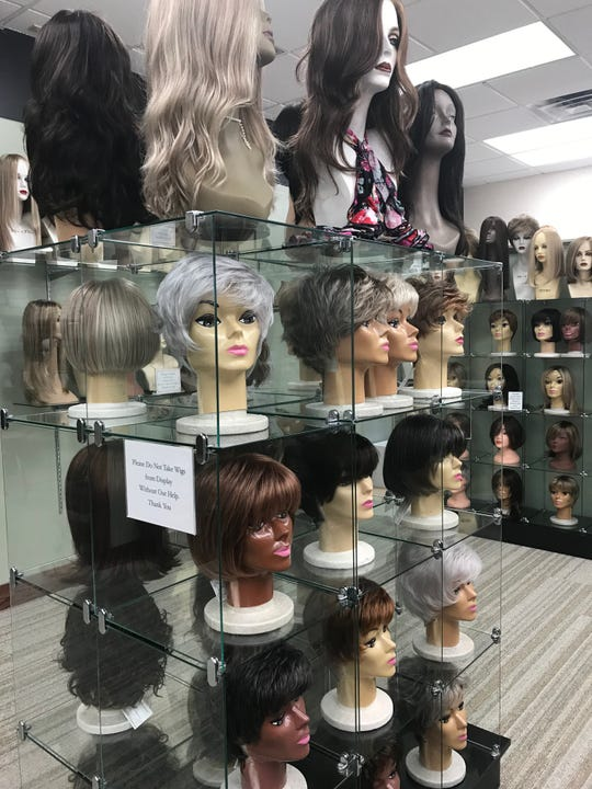 A display of wigs at Elegante Studio on June 25, 2019. The store is across the street from Frandor and has been in business for more than 50 years.