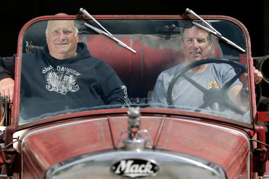 Carl Kuehn and Jeff Keehan sit in the 1935 Mack Type 75 Triple Combination Pumper truck originally owned by the Manitowoc Fire Department Thursday, May 23, 2019, in Manitowoc, Wis. The two spent many long hours working to get the truck running again after it sat in storage for years. Joshua Clark/USA TODAY NETWORK-Wisconsin