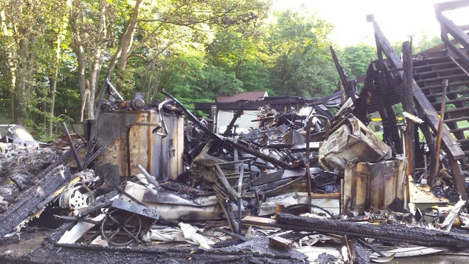 A rural Bellville couple's garage burned down early Sunday morning.