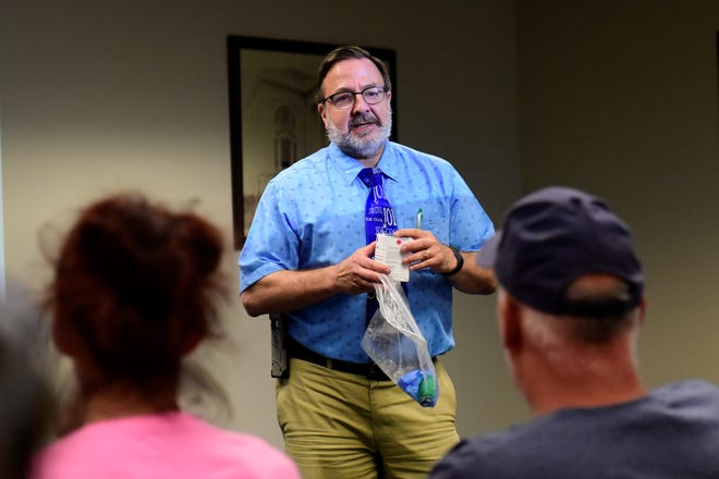 Joseph Bocka, MD, explains how to administer naloxone Tuesday evening to a crowd at the Mansfield/Richland County Public Library.