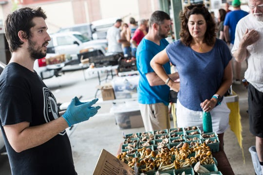 Scott Lisenby, with Bluff City Fungi, talks during a tour of the Memphis Farmers Market with Jennifer Chandler, food and dining reporter at The Commercial Appeal, on Saturday, June 22, 2019. Bluff City Fungi is a certified naturally grown mushroom farm founded in Memphis.