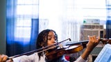 Caesar Sant practices with his violin at home in Memphis. Sant was born with sickle cell anemia, and at 5 years old experienced 3 strokes that temporarily paralyzed him.