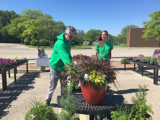 George Holtz, owner of 414 Flowers, and Jessica Moore, director of operations, managed the Southridge mall pop-up location from May 1 to June 30 and plan to return to the mall's parking lot next summer.