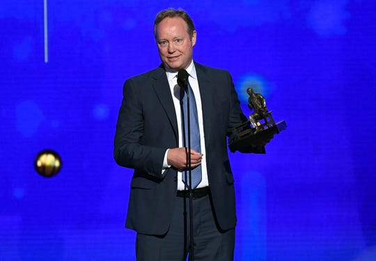 Mike Budenholzer of the Bucks gives a speech after winning the NBA coach of the year award Monday night.