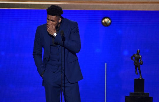 The Bucks' Giannis Antetokounmp reacts as he accepts the MVP trophy on Monday.