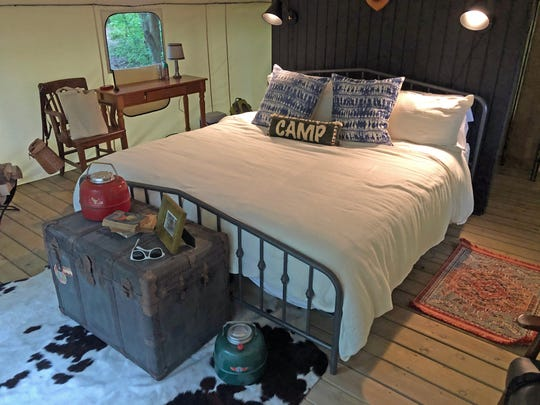 The glamping tents at The Fields include king-size beds, electricity and bathrooms.