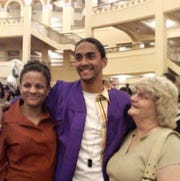 Karin Tyler, from left, takes a photo with her son Andrew Tyler and her mother Susan Hanson at Andrews's high school graduation ceremony from Bradley Tech High School in 2006.