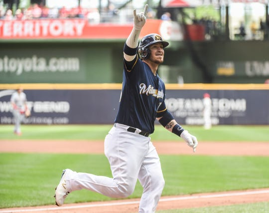Jun 22, 2019; Milwaukee, WI, USA;  Milwaukee Brewers catcher Yasmani Grandal (10) reacts after hitting a solo home run in the first inning against the Cincinnati Reds at Miller Park. Mandatory Credit: Benny Sieu-USA TODAY Sports
