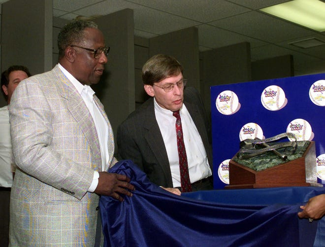 "1999: Former baseball star Hank Aaron (left) and Major League Baseball commissioner Bud Selig unveil the ""Hank Aaron Award"" during a news conference in Atlanta. The award goes to the best hitter in each league annually."
