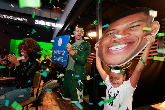 Bucks fan Ximena Guerrero, 6, celebrates when Giannis Antetokounmpo is announced as the MVP at The MECCA Sports Bar and Grill.