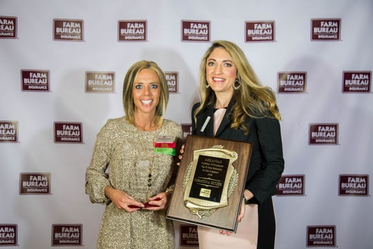 Christina Setzer (left) of Baxter County Farm Bureau was recently recognized for total performance during 2018 at the Farm Bureau Statewide Agents and Agency Managers meeting in Little Rock. Setzer received The FB Bank – #10 In The Company –Total Balances, FB Bank Millionaire's Club and the FB Bank Banker's Dozen. Presenting the award was Allyson Hamlin, director of sales, Farm Bureau Bank.