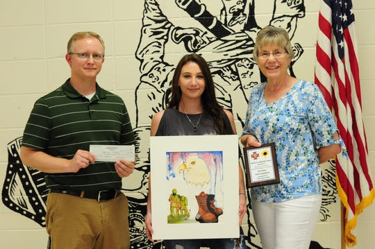 Calico Rock High School's Zoie Stapleton (center) took first place locally and third place in the state in the annual Young American Creative Patriotic Art Contest sponsored by the National VFW Auxiliary. Pictured with Stapleton are Calico Rock art teacher Jonathon Baker (left) and Pat Foster, President of Wilson-Byler Post 7730 Auxiliary.