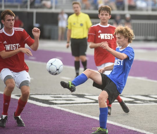 Mountain Home's Koby Weber passes the ball for the East during the AHSCA All-Star soccer games Friday night at Conway.