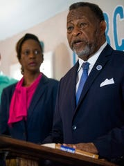 Montgomery County Commission Chairman Elton Dean, with his wife Wanda Dean at his side, talks about crime in Montgomery during a press conference on Tuesday June 25 , 2019 in Montgomery, Ala. Dean is running for Mayor.
