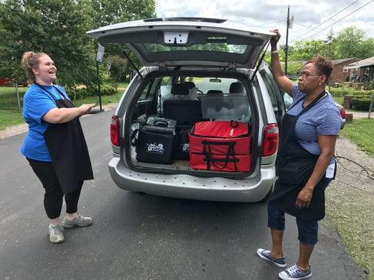 Tiffany Thompson, left, and Gail Campbell, child nutrition program members in Franklin Special School District, said they love working the summer food delivery route because they get to see students during the summer. The duo packs the district van twice a day to deliver breakfast and lunch to Franklin neighborhoods.