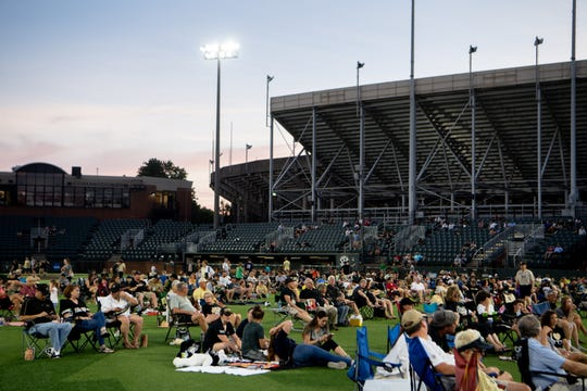 Fans look at the TV during a watch party for the College World Series: Vanderbilt vs. Michigan game at Charles Hawkins Field Monday, June 24, 2019, in Nashville, Tenn.