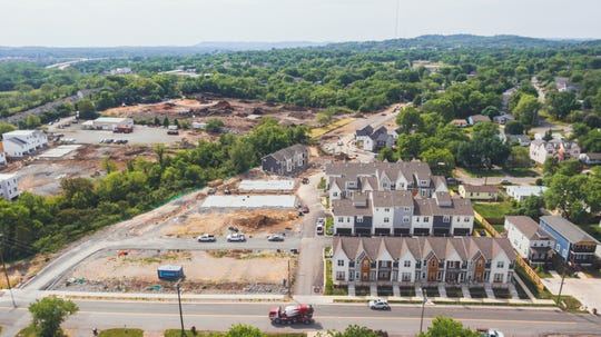 Townhomes at The Annex are transforming a former industrial site near West and Charlotte parks and the Richland Creek Greenway. They are being built by MiKen Development.