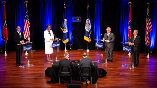 From left, State Rep. John Ray Clemmons, retired Vanderbilt professor Carol Swain, at-large Council member John Cooper, and Mayor David Briley are introduced during a mayoral debate at Belmont University's McAfee Concert Hall in Nashville, Tenn., Tuesday, June 25, 2019.