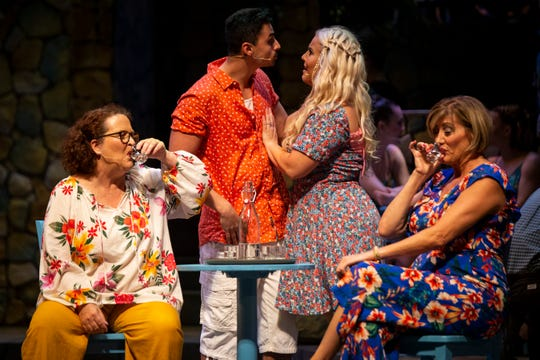 From left to right, Kristin Cassidy, Adam Fasano, Erica Sample, and Debi Guthery act out a scene during a dress rehearsal of Mamma Mia by the Naples Players at Sugden Community Theatre in Naples on Monday, June 24, 2019.