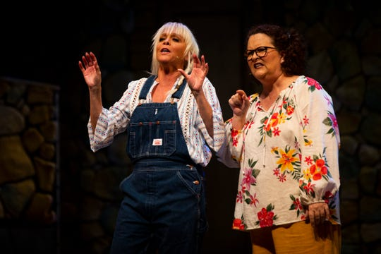 Mary Anne McKerrow, left, and Kristin Cassidy, right, act out a scene during a dress rehearsal of Mamma Mia by the Naples Players at Sugden Community Theatre in Naples on Monday, June 24, 2019.
