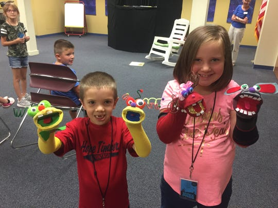 Granville residents Ethan and Olivia Garber came armed with some DIY puppets for the June 24 Granville Library show.