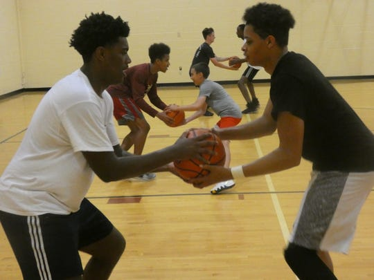 Licking Heights' Jeveon Anderson and Lawrence Thomas work on a defensive shuffle drill during a recent practice.