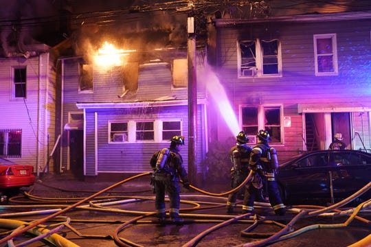 Firefighters battling a five-alarm fire on Summer Street at Oak Street in Paterson, NJ, at about 1:30 a.m. on June 25, 2019.