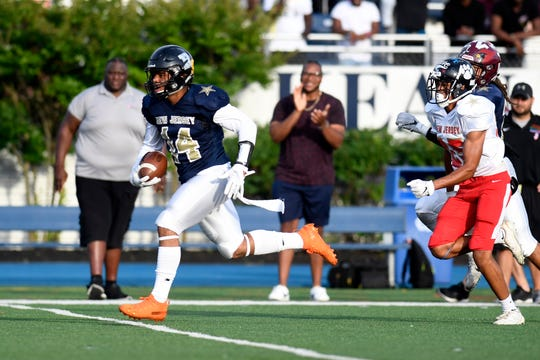 Hasbrouck Heights' Jasiah Purdie (14) runs for a long touchdown for the North team in the first half. The North defeats the South 24-23 in the Phil Simms North-South Football Classic on Monday, June 24, 2019, in Union.