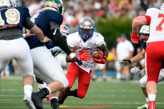 Sayreville's Jacari Carter rushes for the South. The North defeats the South 24-23 in the Phil Simms North-South Football Classic on Monday, June 24, 2019, in Union.