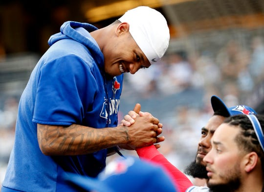 Toronto Blue Jays pitcher Marcus Stroman arm wrestles with teammates before a baseball game against the New York Yankees, Monday, June 24, 2019, in New York. (AP Photo/Kathy Willens)