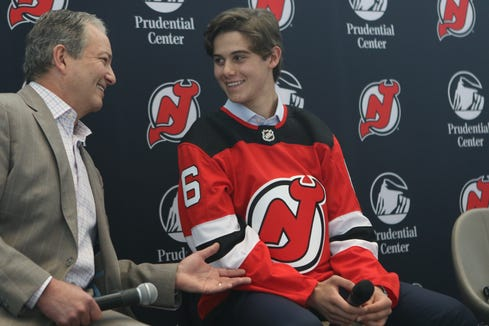 Devils Executive Vice President and General Manager, Ray Shero, is shown with number one draft pick, Jack Hughes, during a press conference, Tuesday June 25, 2019.