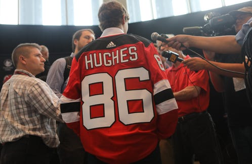 Jack Hughes, is surrounded by members of the press at the Prudential Center, Tuesday June 25, 2019.