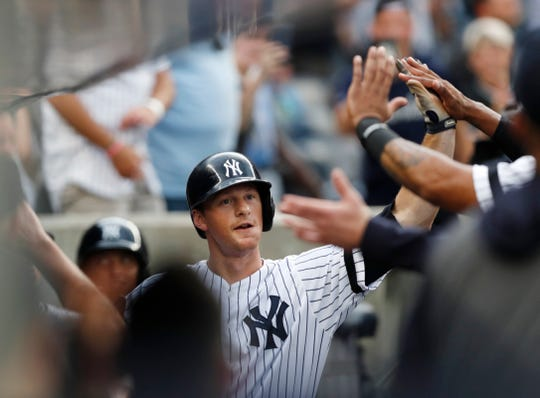 New York Yankees' DJ LeMahieu celebrates with teammates after hitting a solo home run during the first inning of the team's baseball game against the Toronto Blue Jays, Tuesday, June 25, 2019, in New York. With the home run, the Yankees broke a record in the majors for consecutive games with a home run. (AP Photo/Kathy Willens)