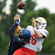 North team's Jamar Casey of Lincoln, left, breaks up a touchdown pass intended for South team's Kaden Hastie of Seneca. The North defeats the South 24-23 in the Phil Simms North-South Football Classic on Monday, June 24, 2019, in Union.