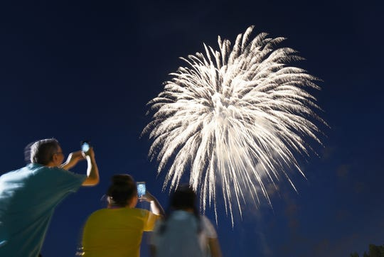 ( L to R), Key Fouea of Jersey City with Mimi Fouda (12), and Souhaila Eokhezzani (12) enjoy watching the fireworks display at Little League Field in Lyndhurst on 07/02/18.