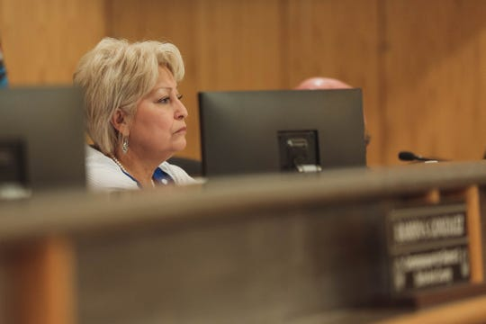 Commissioner Isabella Solis, pictured here at the June 25 meeting, called on her colleague Commissioner Shannon Reynolds to recuse himself over campaign donations and repeatedly claimed that PACE loans saddled low-income residents with adverse consequences.