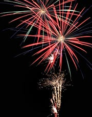 "In this file photo, the night sky and the Town of Mesilla are all aglow Saturday as a fireworks display is set off for the first time in the town in honor of Independence Day. The crowd shouted ""Bravo"" and they whistled, clapped and shouted after the grand finale."