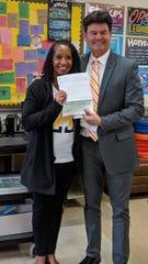 Alamogordo High School cheer team received a $1,000 athletic grant.