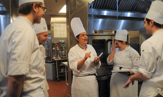 Master Baker Heather Moore joking around with a few of her students at Schoolcraft College before class begins. Moore became Schoolcraft's first master baker in May.